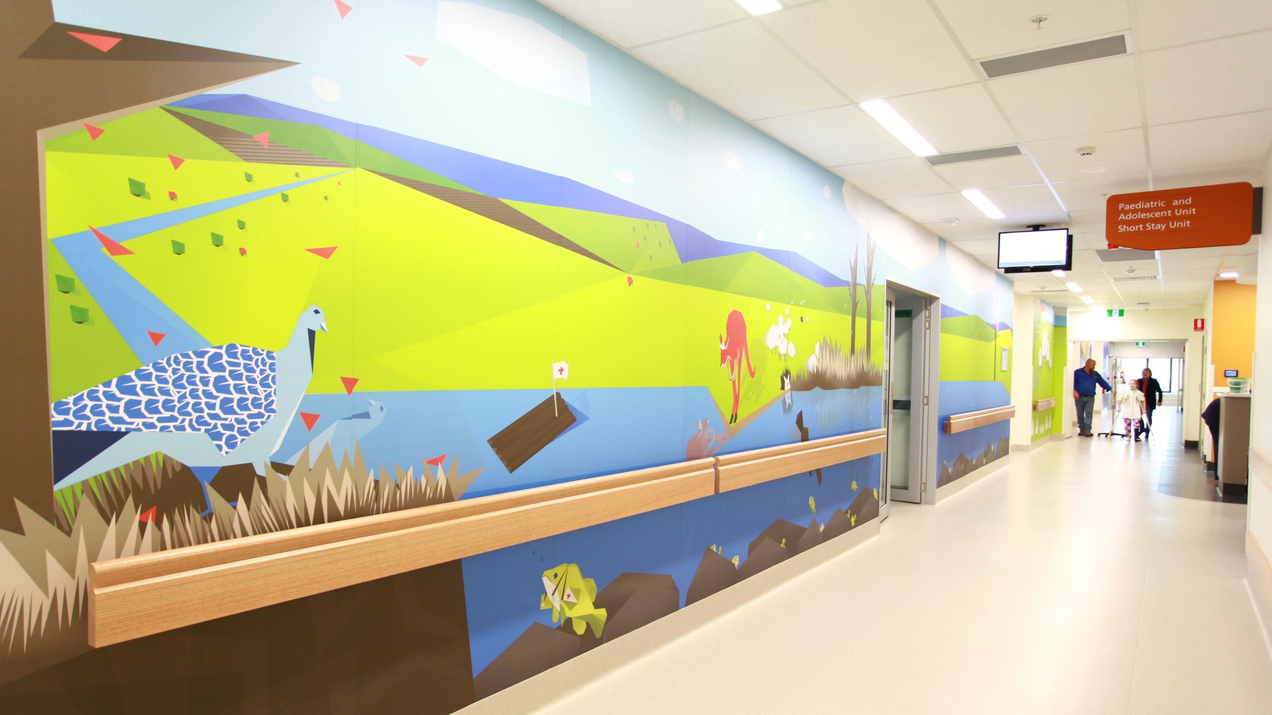 Rachel was selected by the Murrumbidgee Local Health District (MLHD) Arts Strategy Panel to transform 140m2 of space in the Wagga Wagga Rural Referral Hospital Children's Ward into a healing and hopeful environment using graphic vinyl. The artwork allows staff, patients and visitors to step inside a giant children's book and follow a timid malleefowl named Mallie on his adventure. Mallie's story unfolds as you move through the ward, with animals representing doctors and nurses helping him on his journey.